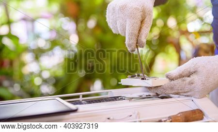 Asian Man Online Learning And Repair Air Conditioner At Home. Social Distancing And New Normal Lifes