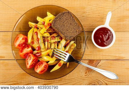 Pieces Of Red Tomatoes, Slice Of Bread And Slices Of Fried Potatoes In Transparent Brown Plate, Fork