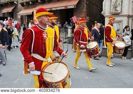 Siena, Italy - April 28: The Contrada Of Valdimontone (valley Of The Ram), Parade Through The Street