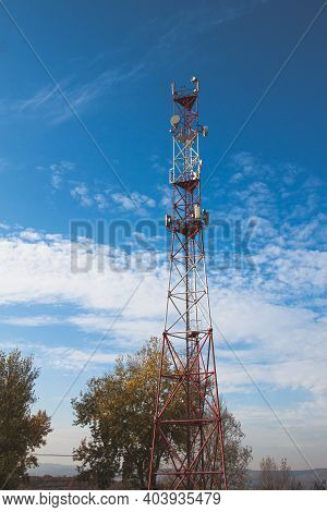 4g 5g Cellular Repeaters Against A Blue Sky. Mobile Phone Telecommunication Radio Antenna Tower