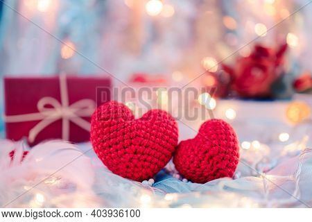 Heart Shape, Foam Beads, Feather, Gift Box And Light Decorative Bokeh On Blue Cloth. Love, Valentine