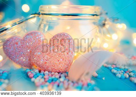 Heart Shape, Foam Beads, Feather And Light Decorative Bokeh On Blue Cloth. Love, Valentine And Holid
