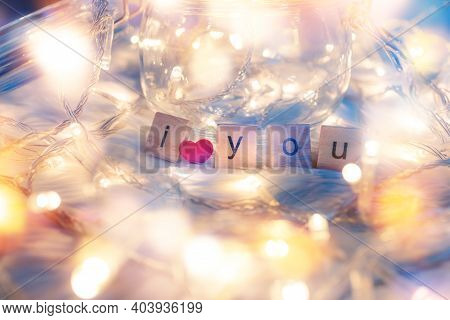 Wooden Letter Block And Heart Shape On White Cloth And Light Decorative Bokeh. Love, Valentine And H
