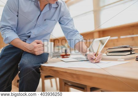 Businessman Using Pencil Checking Document Data Calculator For Calculate Budget Accountancy. Finance