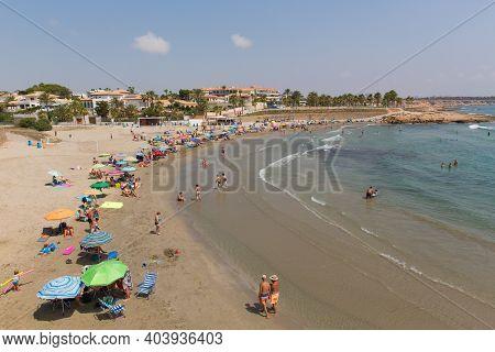 Playa Cala Estaca, La Zenia, Spain-july 1st 2019: Beautiful Summer Weather Attracted Holidaymakers T