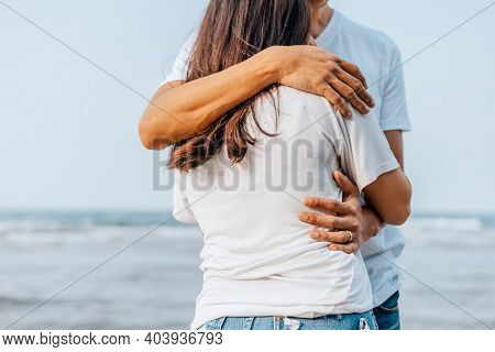 Romantic Couple Hug Together On The Beach At Summer. Honeymoon, Travel, Holiday, Summer Concept.