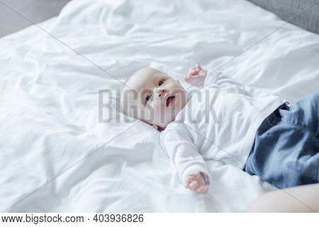 Cute Baby On White Bed. Baby, Newborn Concept.