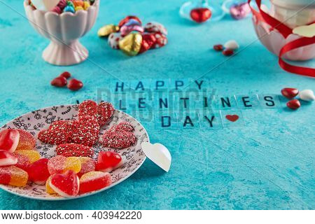 Valentine's Day Or Romantic Dinner With Candy Hearts, Glasses Of Champagne And Elegant Table Setting
