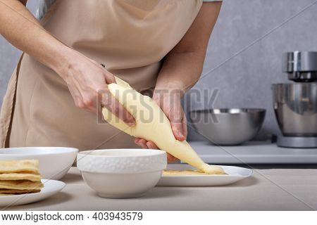 Pastry Chef Squeezes Cream Out Of The Culinary Bag. Pastry Bag. Cream Injector. Culinary Syringe.