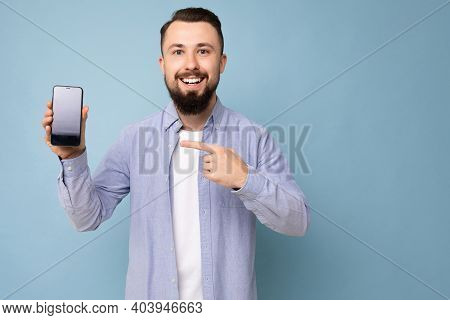 Photo Of Handsome Smiling Adult Male Person Good Looking Wearing Casual Outfit Standing Isolated On