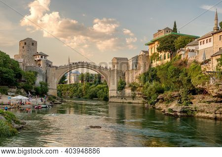 Mostar, BiH - August 30, 2019: Stari Most bridge at sunset in old town of Mostar, Bosnia and Herzegovina. Mostar cityscape at summer