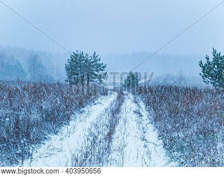 The Dirt Road Is Covered With Snow Of A Winter Blizzard. Snow Blizzard. Down Road. Winter Season. Me