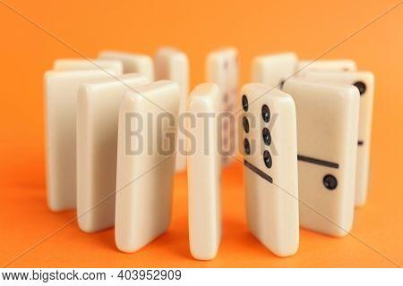 White Domino Tiles With Black Pips On Orange Background