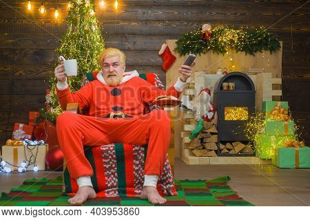 Santa Claus Costume. New Year. Merry Christmas. Santa Claus. Christmas. Santa Claus Sit On Armchair.