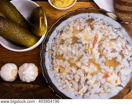 Jelly With Meat, Beef , Traditional Russian Dish, Portion On A Plate, Mustard And Horseradish