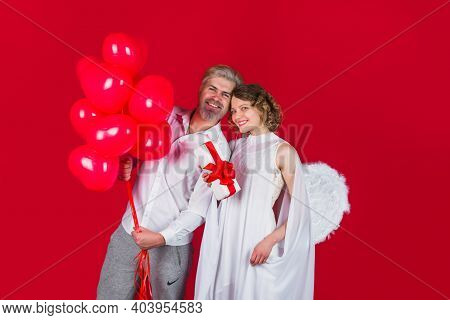 Valentines Day Advertising. Valentines Day Cupids. Angel With Gift And Balloons. Cupid In Valentine