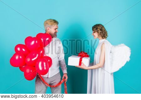 Valentines Day. Lovely Valentines Day Couple. Cupid Angel With Presents And Balloons. Couple Of Cupi