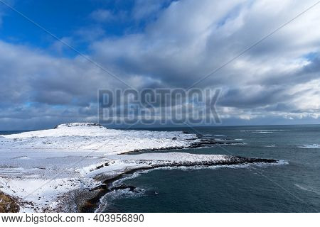 Beautiful Winter View Of Picturesque Atlantic Ocean In Iceland. A Waves Of The Atlantic Ocean Hit Th