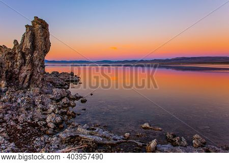 Magic sunset on the lake. Lime-tuff towers of bizarre shapes rise from the bottom of the lake. The natural wonder of the world is   Mono Lake, a salt lake in California.