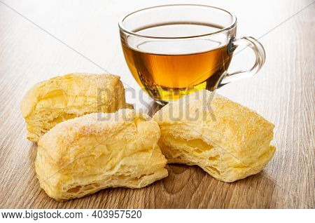 Transparent Cup With Tea, Puff Cookies On Brown Wooden Table
