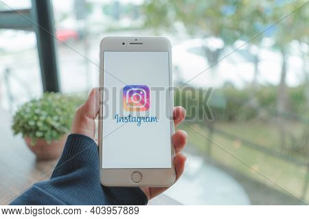 Chiang Mai, Thailand - Sep. 20,2020: Man Holding Iphone With Instagram Application On The Screen. In