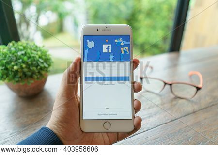 Chiang Mai, Thailand - Sep. 20,2020: Woman Holds  Apple Iphone 8plus With Facebook Application On Th