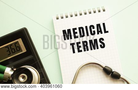 Notepad With Text Medical Terms, Calculator And Stethoscope On White Background. Medical Concept.