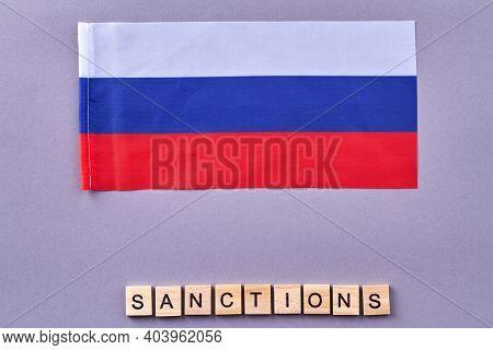 Russian Sanctions Concept. Wooden Cubes On Purple Background.