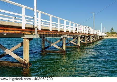 The Heritage Listed 1.8 Kilometres Long Busselton Jetty Over The Waters Of Geographe Bay Is The Long