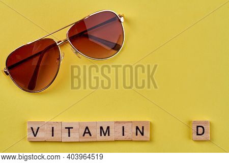 Sunglasses And Vitamin D Made Of Wooden Blocks. Concept Of Summer Resort.