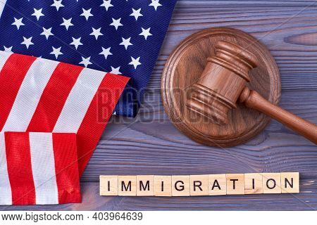 Immigration Law In The Usa. Immigration Word Made Of Wooden Blocks. Vertical Shot Dark Wood Backgrou