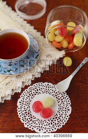 Tea with colored sugar candies