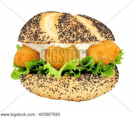 Battered Cod Fish Nugget Sandwich With Lettuce In Crusty Poppy Seed Covered Bread Roll Isolated On A