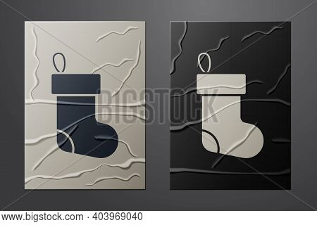 White Christmas Stocking Icon Isolated On Crumpled Paper Background. Merry Christmas And Happy New Y