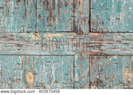Old Wood Texture Background With Teal Colored Chipped Paint And Staples
