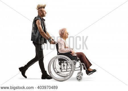 Punk rocker pushing an elderly woman in a wheelchair isolated on white background