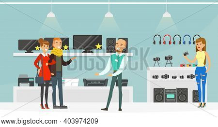 Male Shop Assistant Helping People Choose Electronics At Shopping Mall, Modern Electronics Store Or