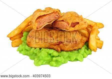 Spam Fritters And Chips Meal With Mushy Peas Isolated On A White Background