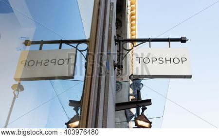 London / Uk - November 5th 2020 - Topshop Store Sign Reflected In A Store Window On Oxford Street. T