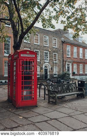 London, Uk - October 10, 2020: Red Phone Boxes On Richmond Green In Richmond. Red Phone Boxes Can Be