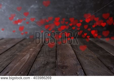 Blurred Red Hearts Float On Dark Vintage Background. Romantic Concept With Short Depth Of Field For