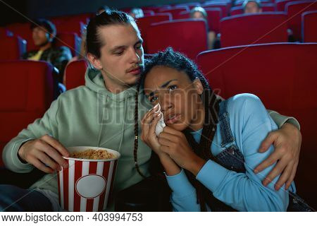 Attractive Mixed Race Young Woman Crying, Looking Emotional While Watching Movie Together With Her B