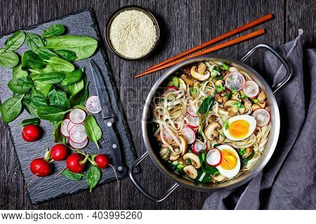 Udon Noodle Soup Asian Dish Of Kakejiru Broth Based On Dashi,soy Sauce And Mirin With Spinach, Radis