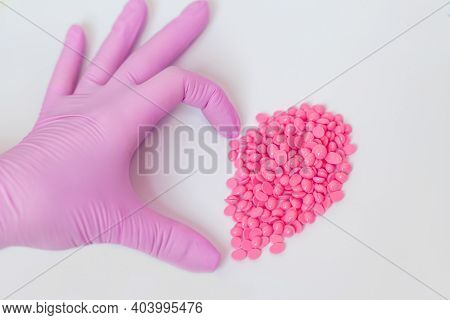 Wax For Depilation Of Pink Color. In The Form Of A Heart. On White Background. The Concept Of Waxing
