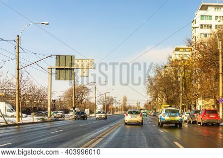 Traffic Cars With Road View Through Car Windshield In Bucharest, Romania, 2021