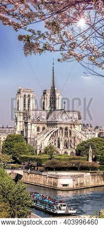 Paris, Notre Dame Cathedral With Boat On Seine During Spring Time In France