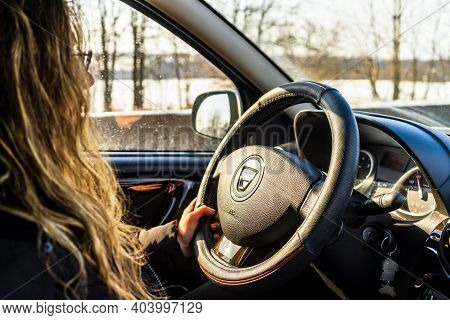 Driving Dacia, Close Up Of Dashboard, Steering Wheel With Air Bag Sign. View Of Car Interior In Buch