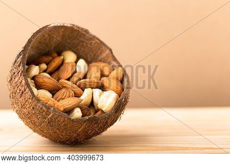 Almonds, Cashew Nuts In Bowl Close Up. Vegan Protein Source, Copy Space
