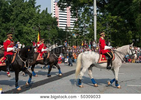 KUALA LUMPUR - AUGUST 31: Troopers and horses from the calvary unit of the Armor Regiment take part in a parade celebrating Malaysia's Independence Day on August 31, 2013 in Kuala Lumpur, Malaysia.