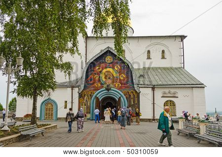 POCHAYIV, UKRAINE - AUGUST 14: Unidentified believers and tourists in Holy Dormition Pochayiv Lavra, Pochayiv, Ukraine on August 14, 2013